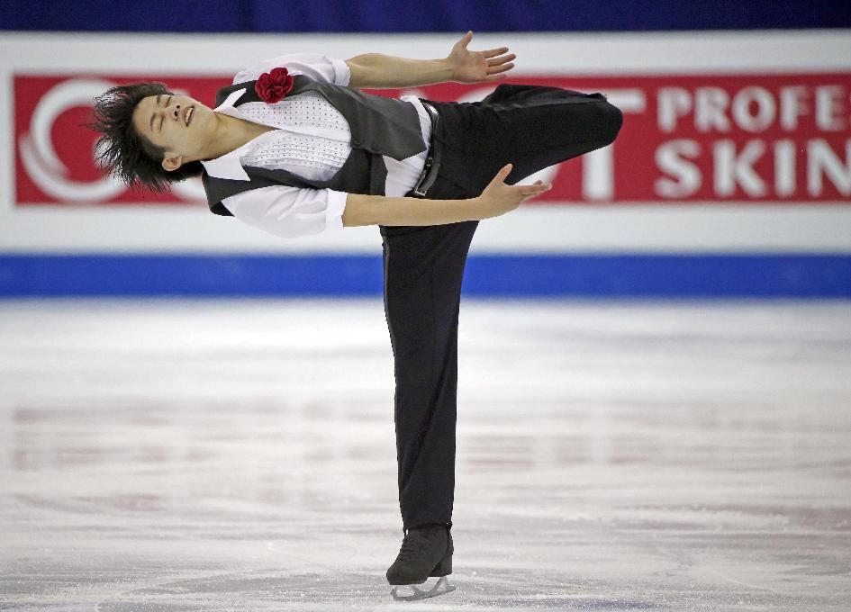Takahiko Kozuka of Japan performs during the Mens Short Program event in the ISU World Figure Skating Championship 2015 held at the Oriental Sports Center in Shanghai, China, Friday, March 27, 2015. (AP Photo/Ng Han Guan) (945×680)