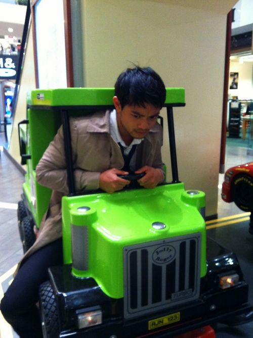 "Osric dressed as Cas riding a kiddie car for GISHWHES - ""There was something you always wanted to do as a child but never did. Do it."""
