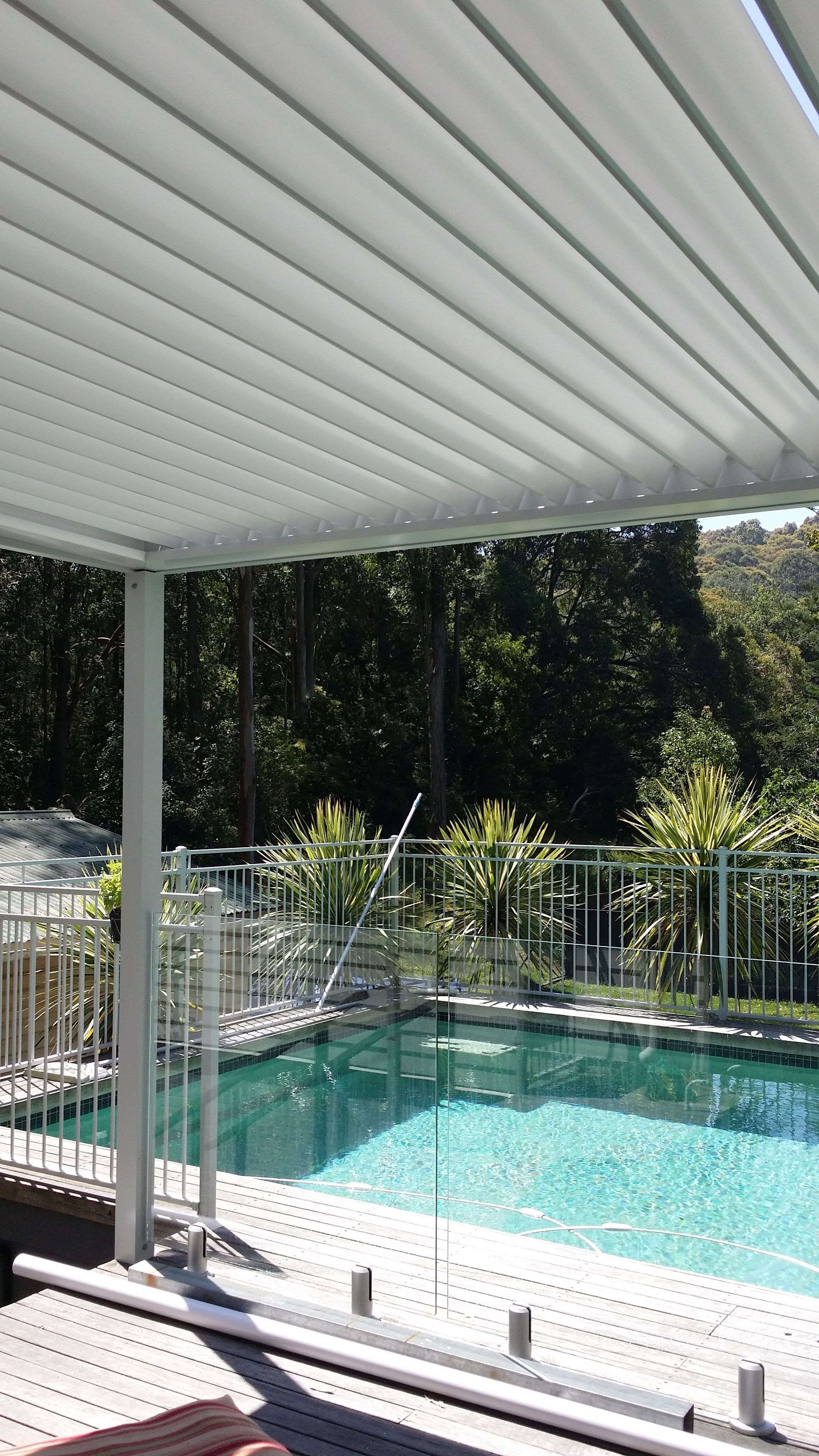 timber deck with glass handrail for pool safety and great vision
