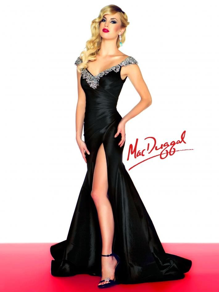 If short dresses aren't your thing, but you'd like to give those toned tanned lower limbs of yours a turn under the spotlight, try thigh-high slits. Sexy, right?  Dress: Style #76363R from Mac Duggal Black White Red