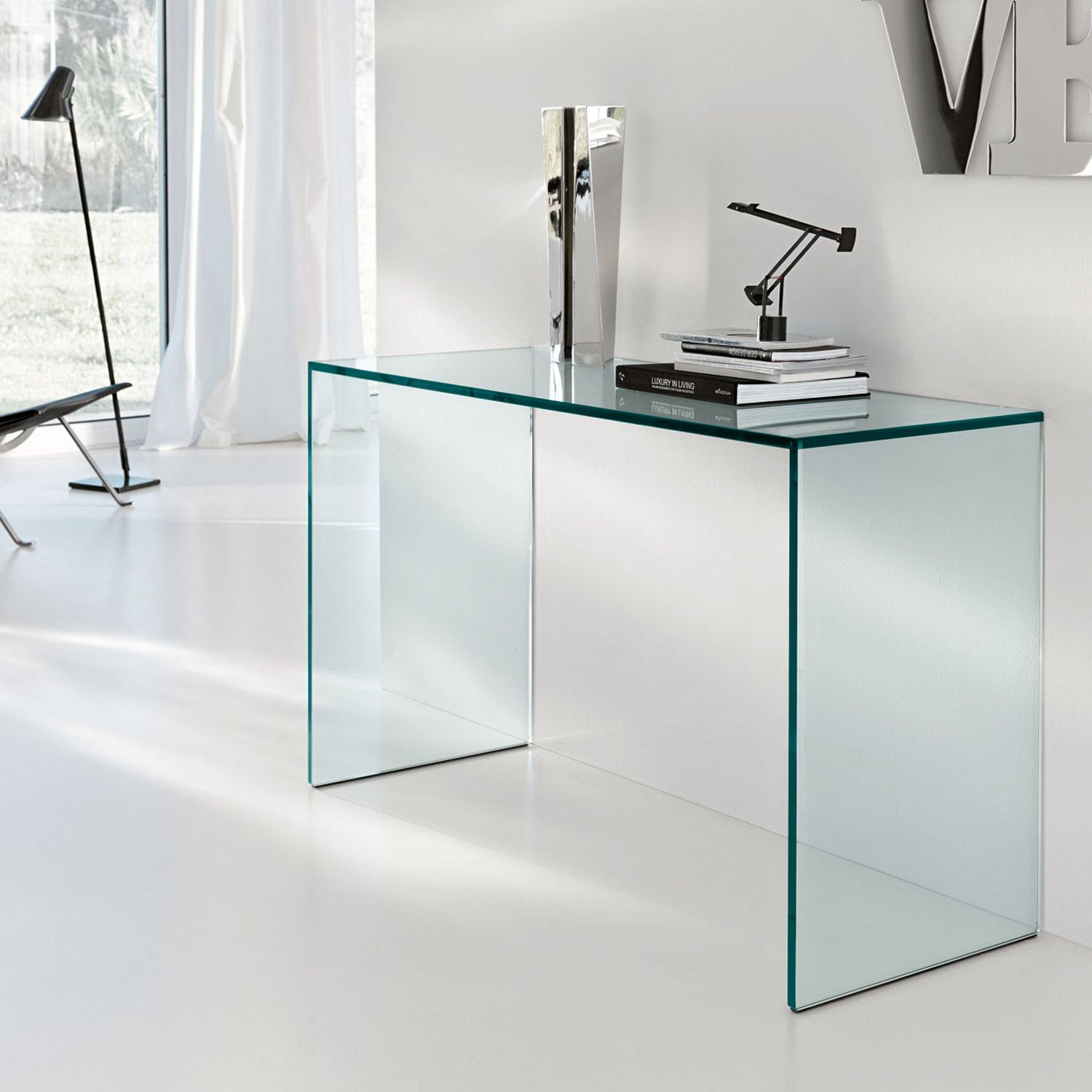 Iconic Glass console table manufactured in luxurious 15mm toughened glass. The Gulliver Glass Console Table by Tonelli is formed from 3 single sheets of glass and is available in 2 standard sizes, Clear or extra clear glass.  Bespoke sizes are available - please contact us for more information.