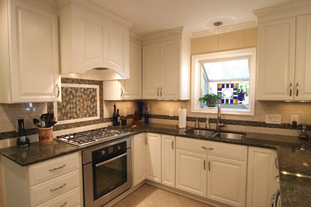 Love the white cabinets, backsplash and dark countertops ...