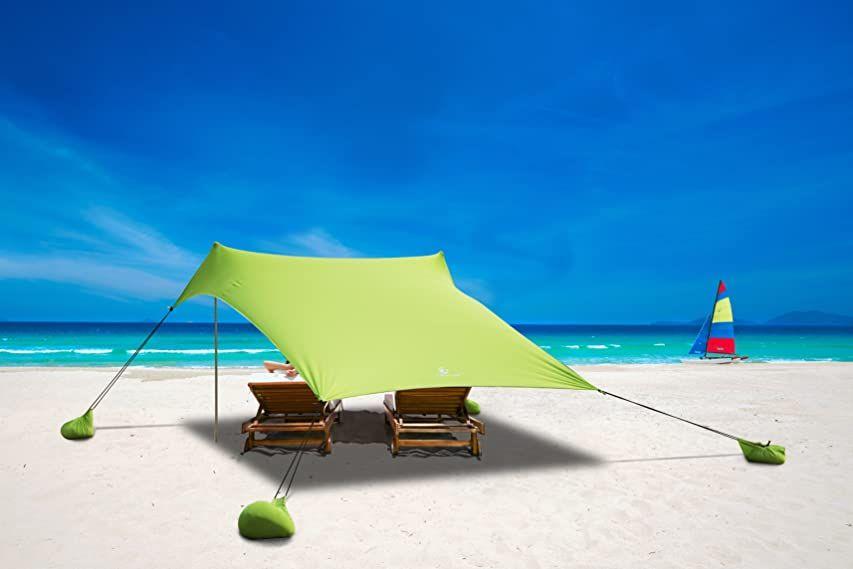 Amazon Com Ziggyshade Family Beach Sunshade Lightweight Sun Shade Tent With Sandbag Anchors 4 Free Pegs Upf50 In 2020 Sun Shade Tent Shade Tent Portable Canopy