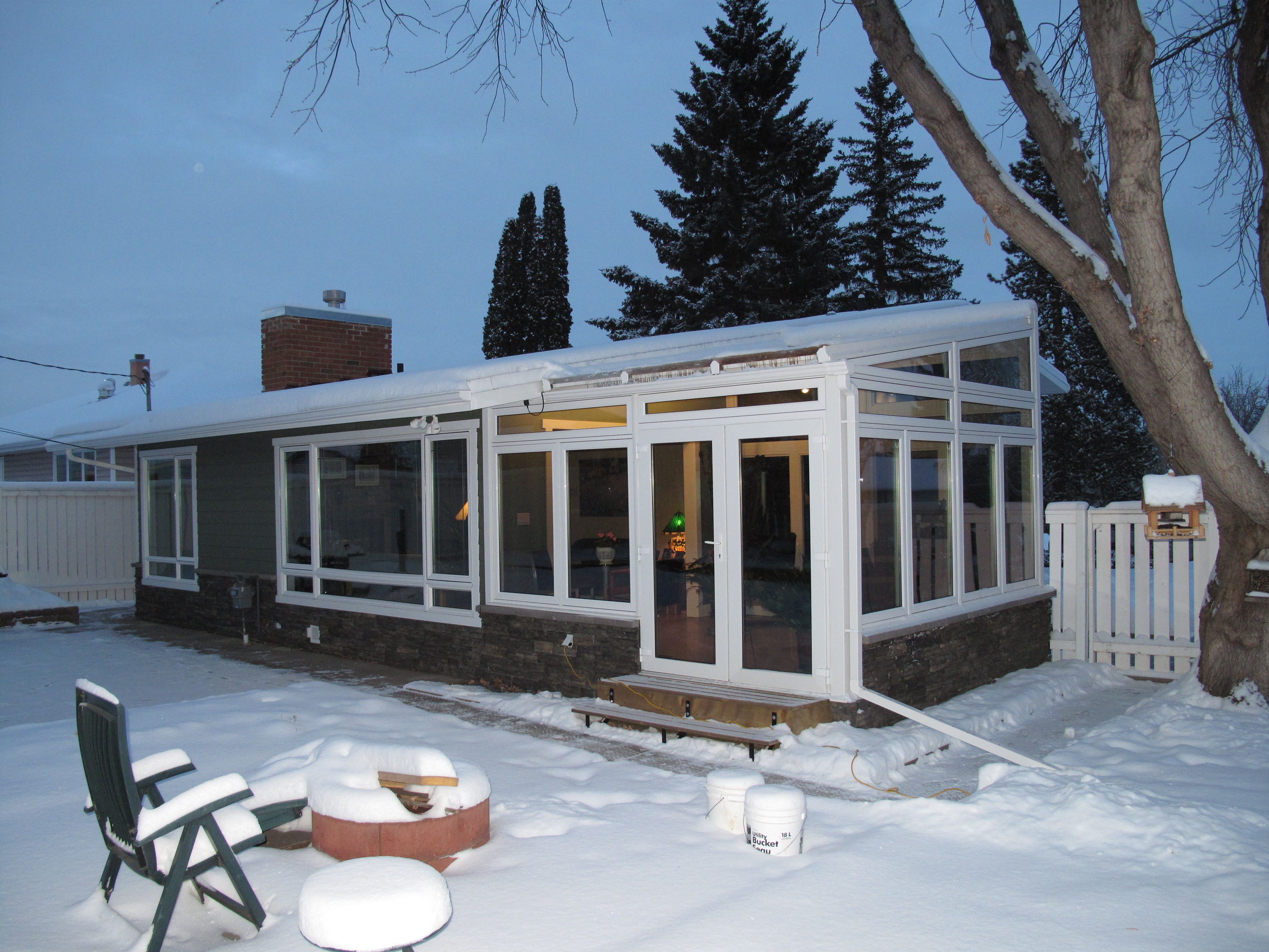 Four Season sunrooms mean heat year round. We get COLD, but inside it should be nice an toasty. But use a reputable contractor, experience is must have here.