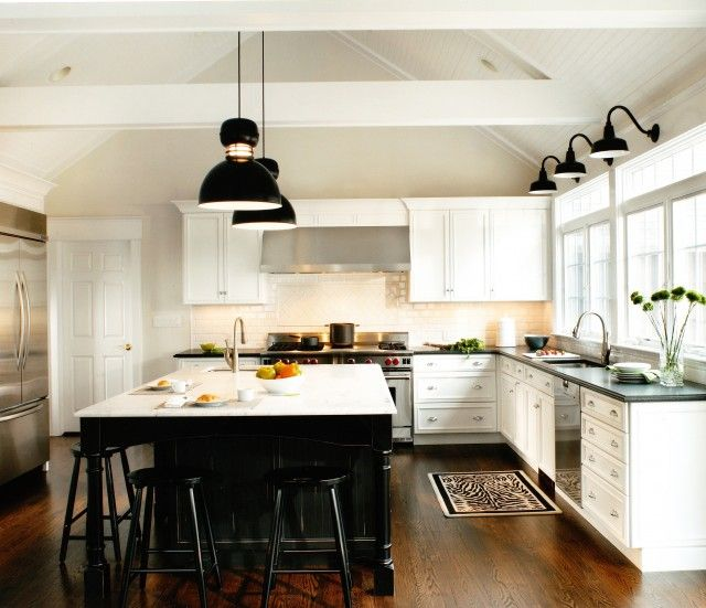 White Kitchen with Black Island and Lighting