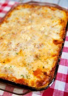 The Best Baked Spaghetti - delicious spaghetti casserole! Hamburger/Sausage, spaghetti sauce, eggs, parmesan, pasta, ricotta, sour cream and mozzarella. Also makes a great freezer meal!