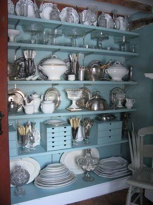Pantry: Walls & shelves painted the same color.