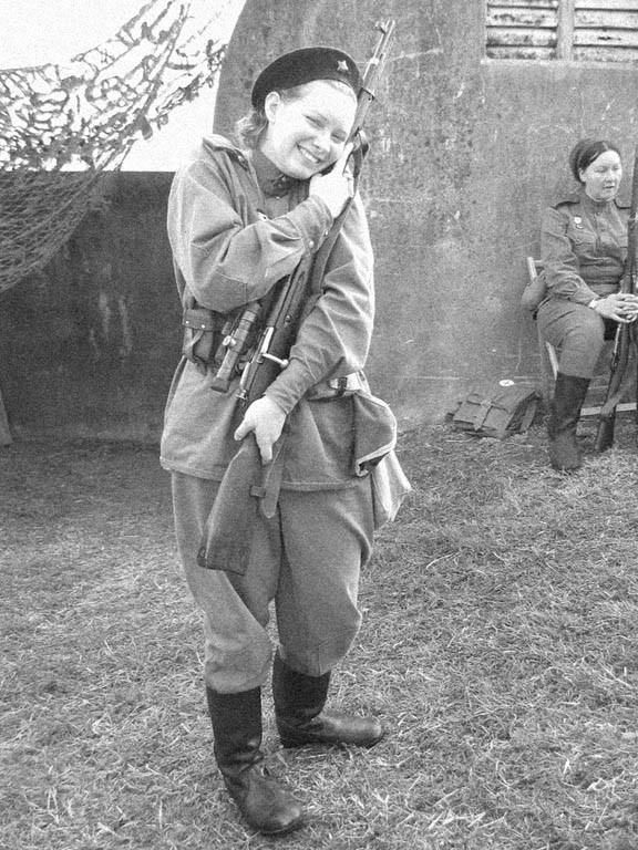 """This is my rifle!"" Love at first sight! A Soviet sniper with her Mosin-Nagant 91/30. The rifle is equipped with a 3.5x PU scope."