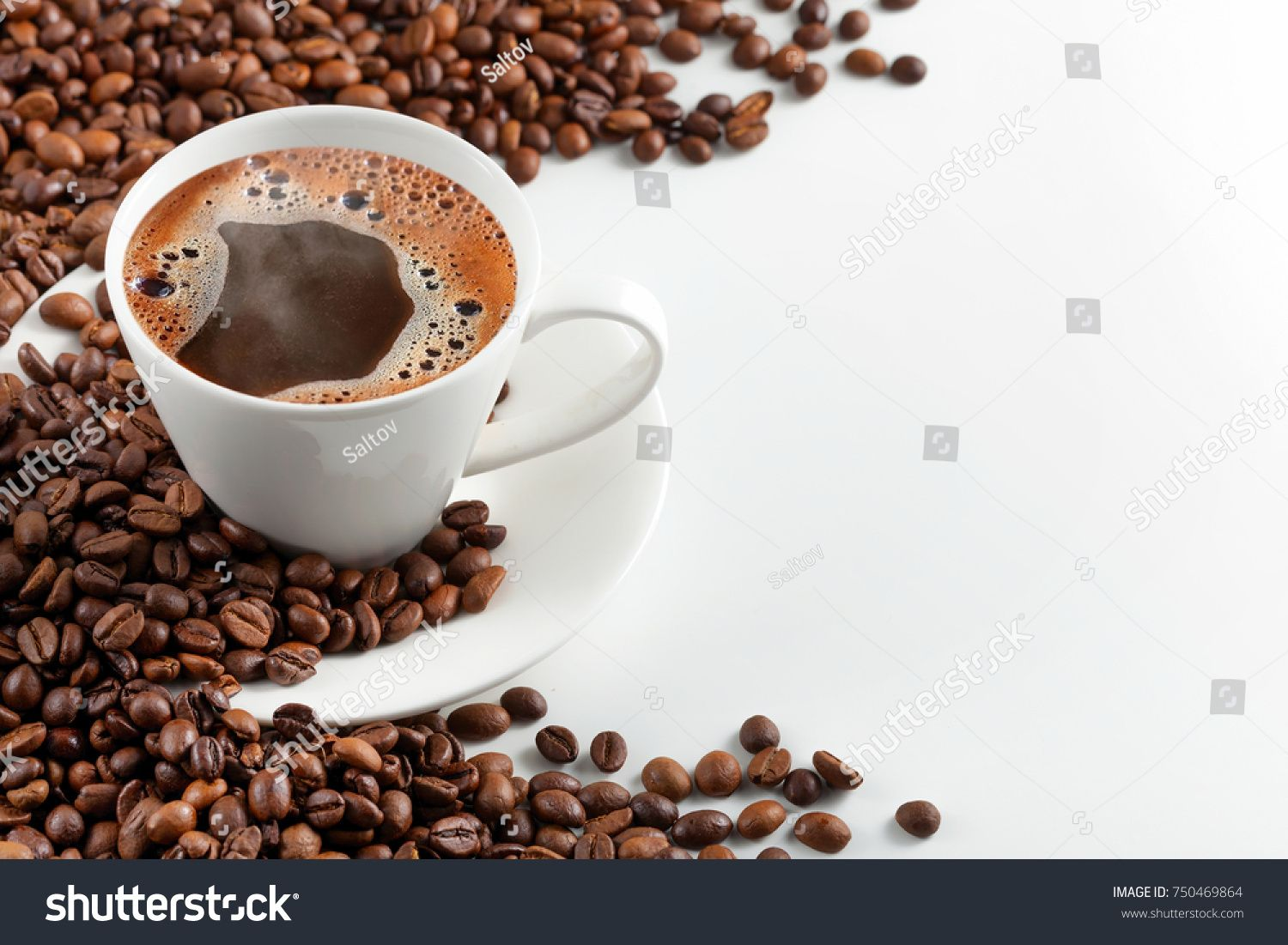 A Cup Of Hot Coffee With Foam In A Scattering Of Coffee Beans On A