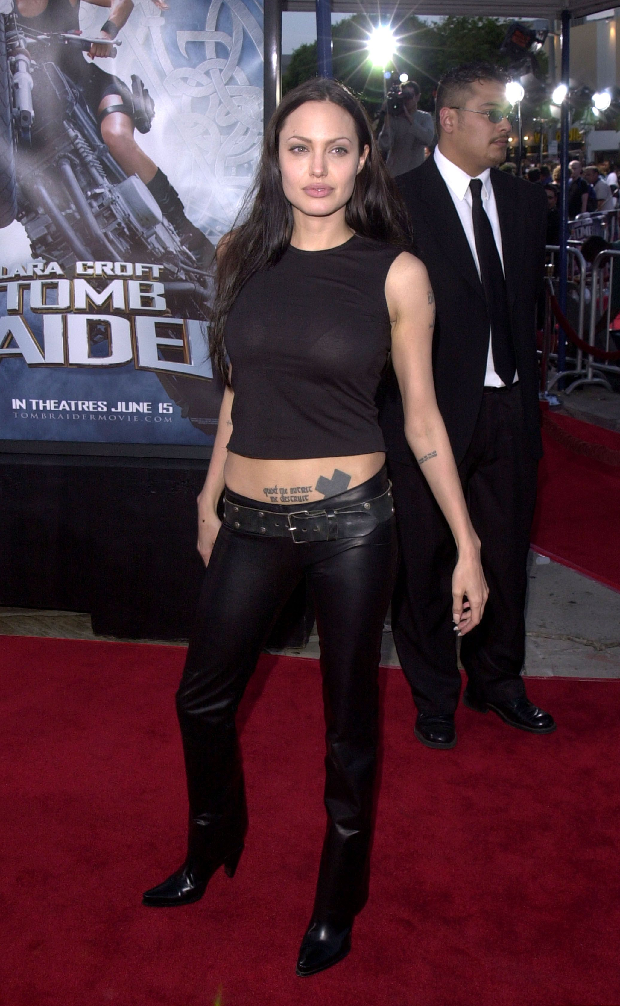 9a8139f9f07 Angelina Jolie s tattoos peered out from under her leather pants at the  June 2001 LA premiere of Lara Croft  Tomb Raider.