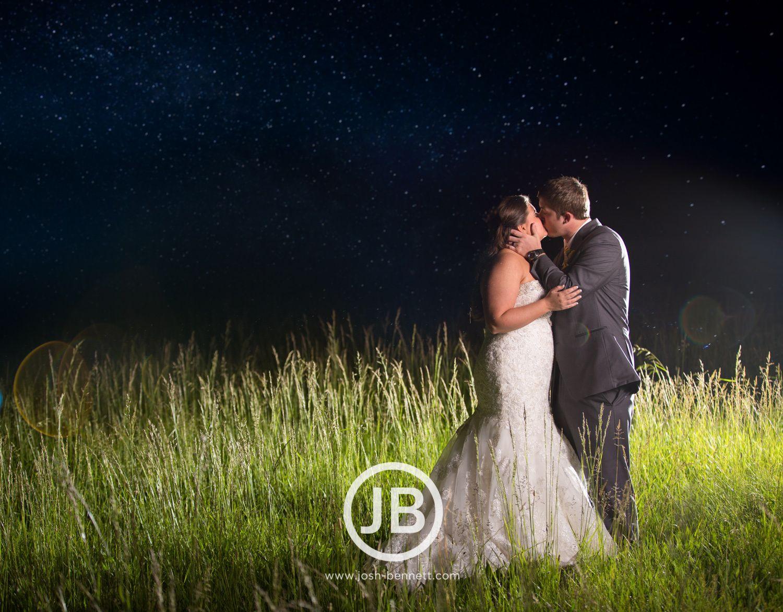 Kiss under the stars wedding day picture. Nashville Wedding Photography by Josh Bennett