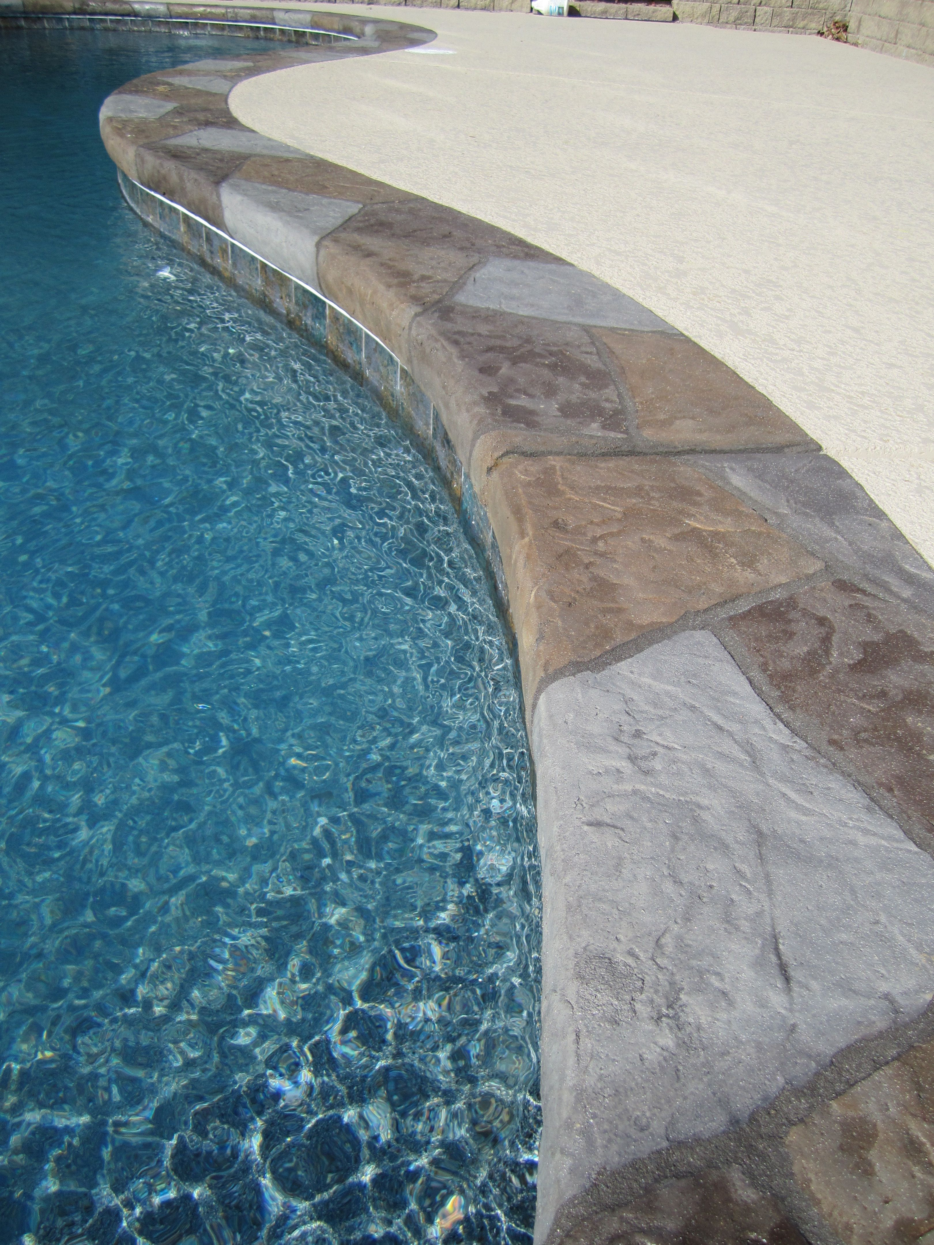 Wow what a beautiful stamped stone design feature for this pool deck concrete for Paint for inground swimming pool coping