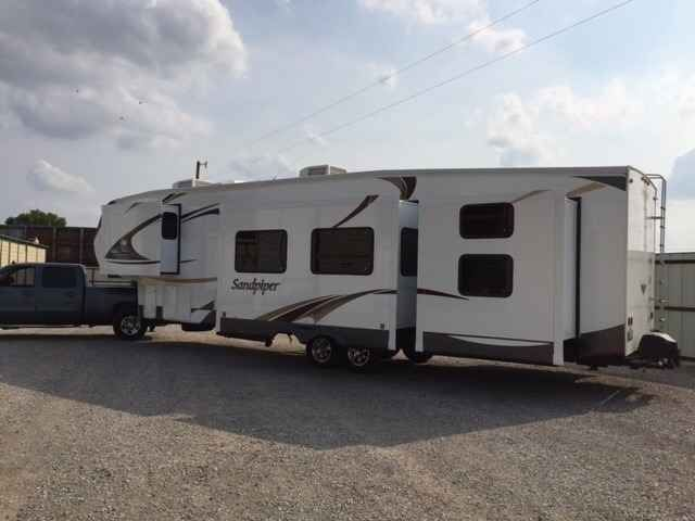 2013 Used Forest River Sandpiper Fifth Wheel in Oklahoma OK.Recreational Vehicle, rv, 2013 Forest River Sandpiper , Like new inside and out. Stored inside since new. King bed. Remote control jacks, slides and awning. Washer dryer hookup. Generator prep. Second AC in front bedroom. Water filter. Conversion for queen bed in rear can be included. Outside kitchen with fridge and microwave. Swing out grill. $36,000.00 4058313369
