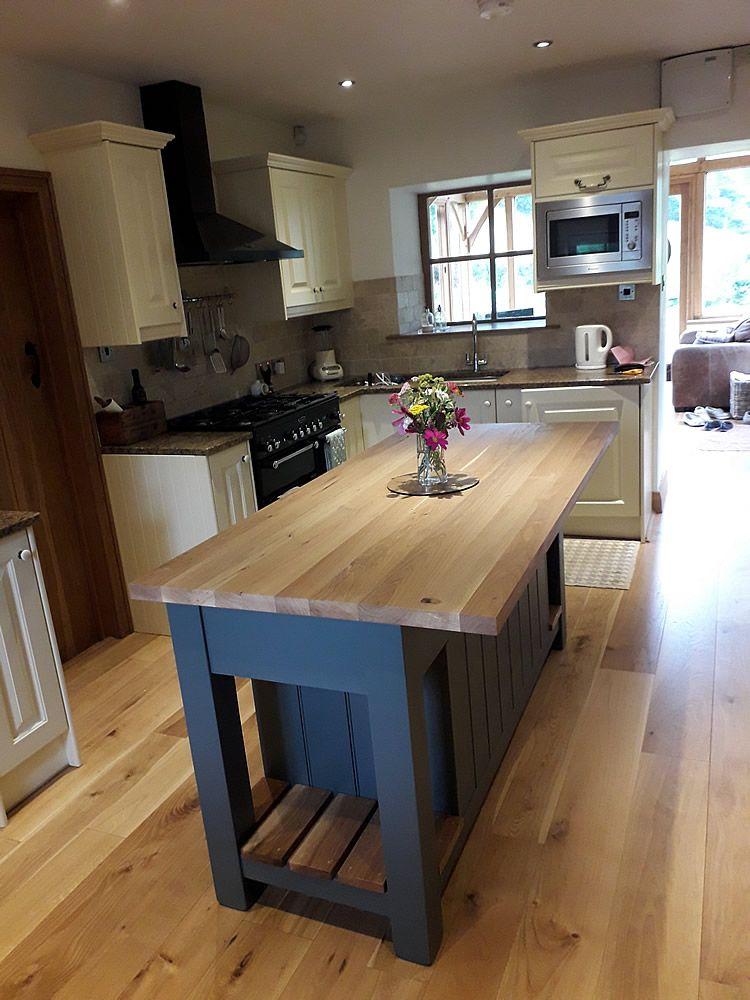 Medium freestanding kitchen island hand painted in Farrow