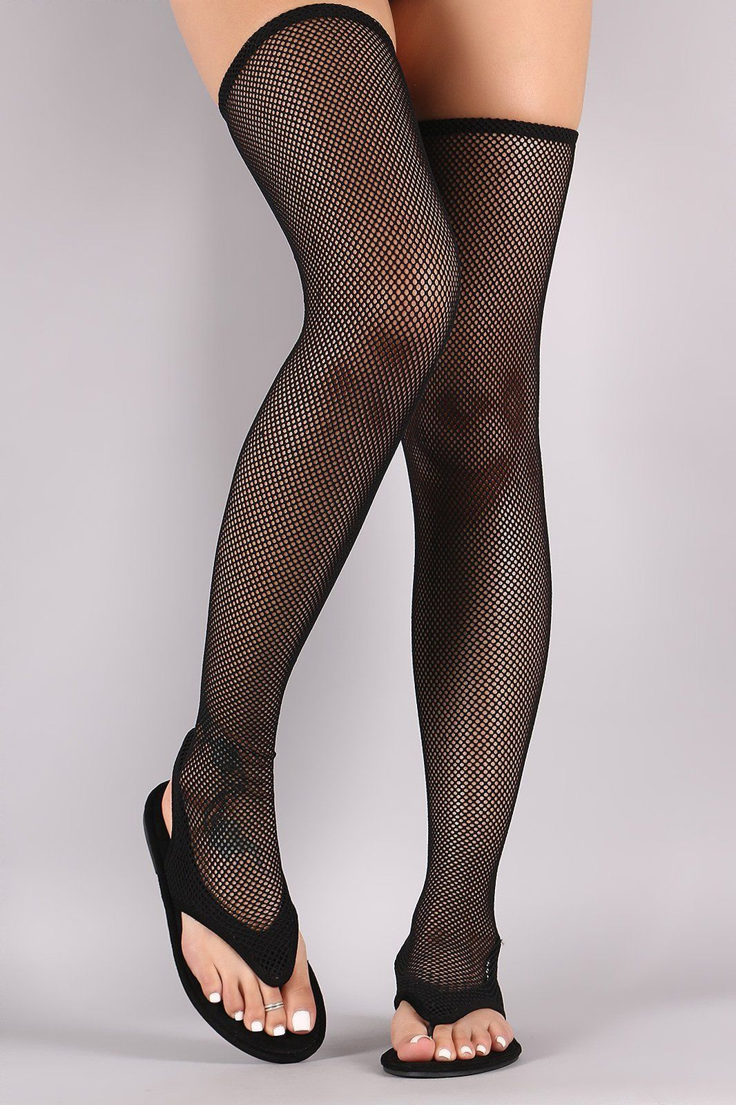 3598bbdb4af These vegan suede flat sandals features a thigh-high fishnet mesh design
