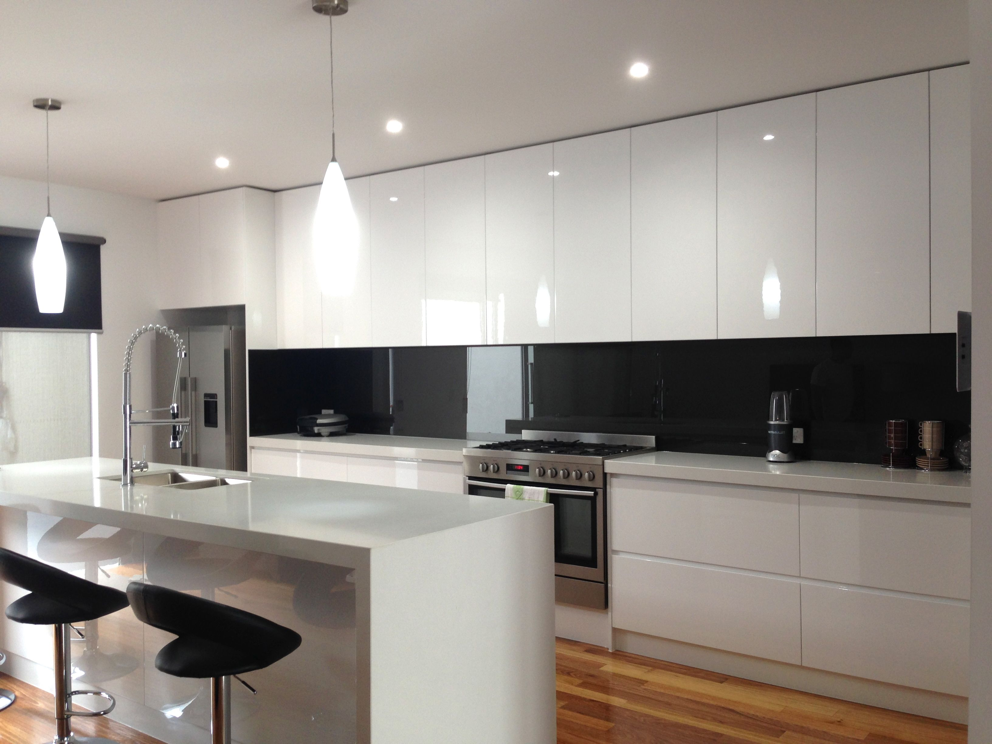 White Kitchen Mirror Splashback get a similar look to a mirror with a black glass splashback from