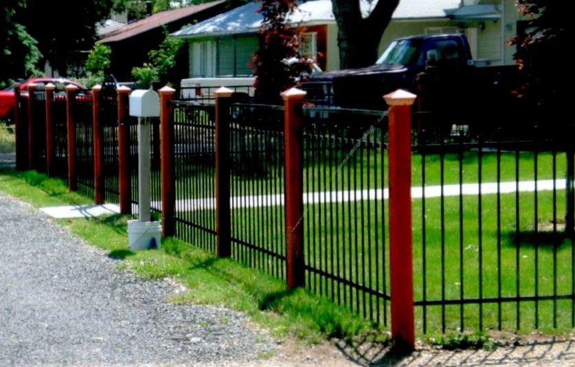 Iron Fence With Wood Posts Custom Done By Frontier Fence Company In Boise Idaho And Treasure Valley Backyard Fences Iron Fence Fence