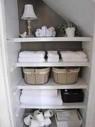 Image result for bathroom cupboard under roof