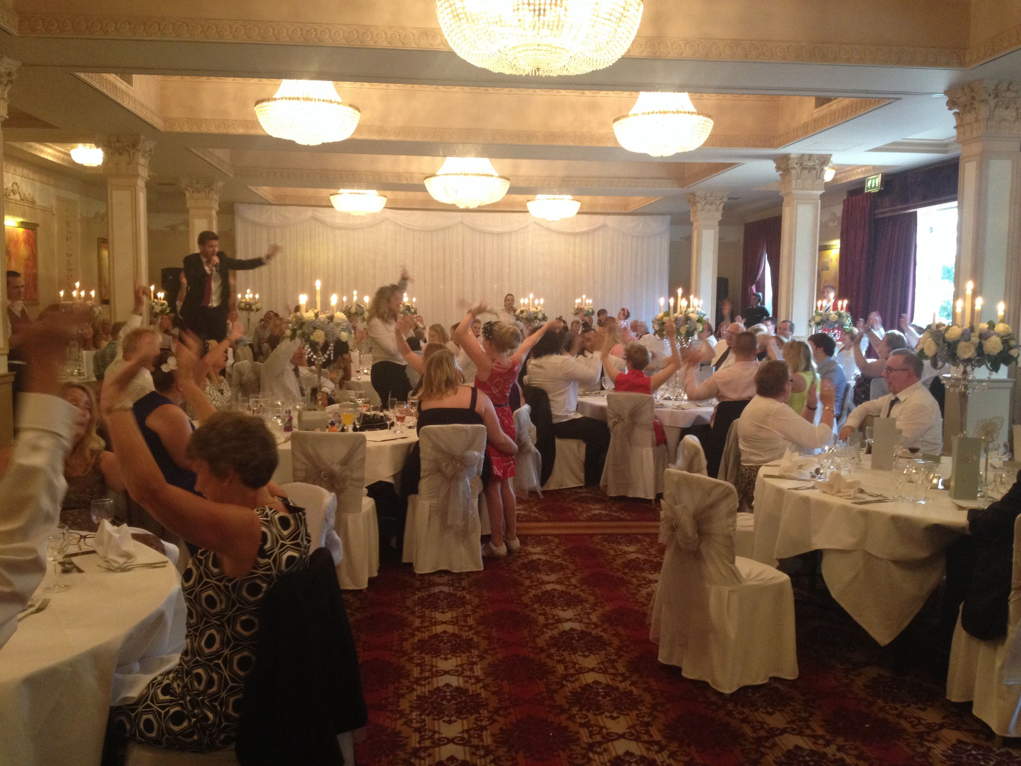 Guests enjoying the surprise singing waiters at a recent wedding