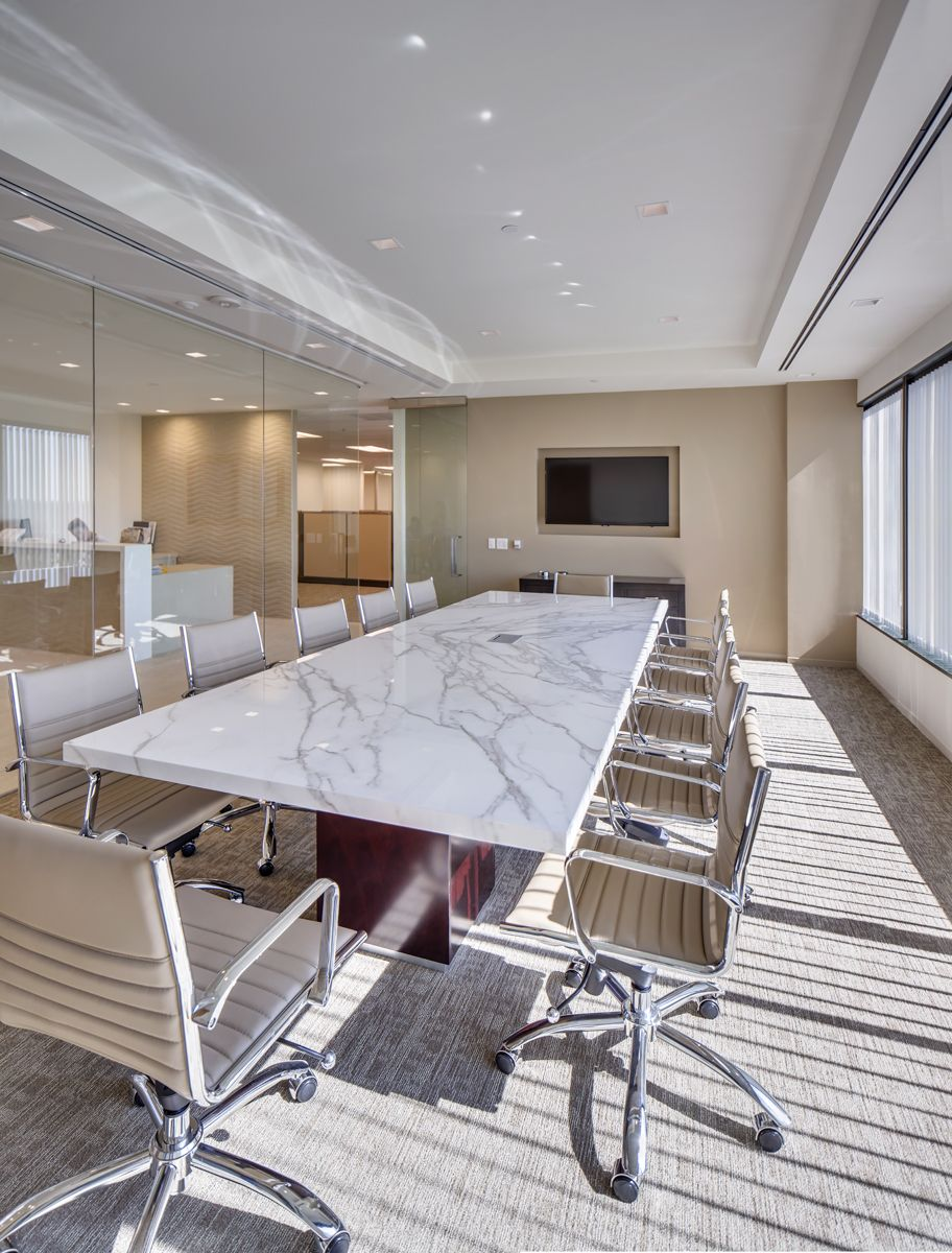 Conference Room Lighting Design: Neolith Calacatta Conference Table Paired With Eames