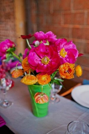 fuchsia and orange flower arrangements // photo by SloanPhotographers.com