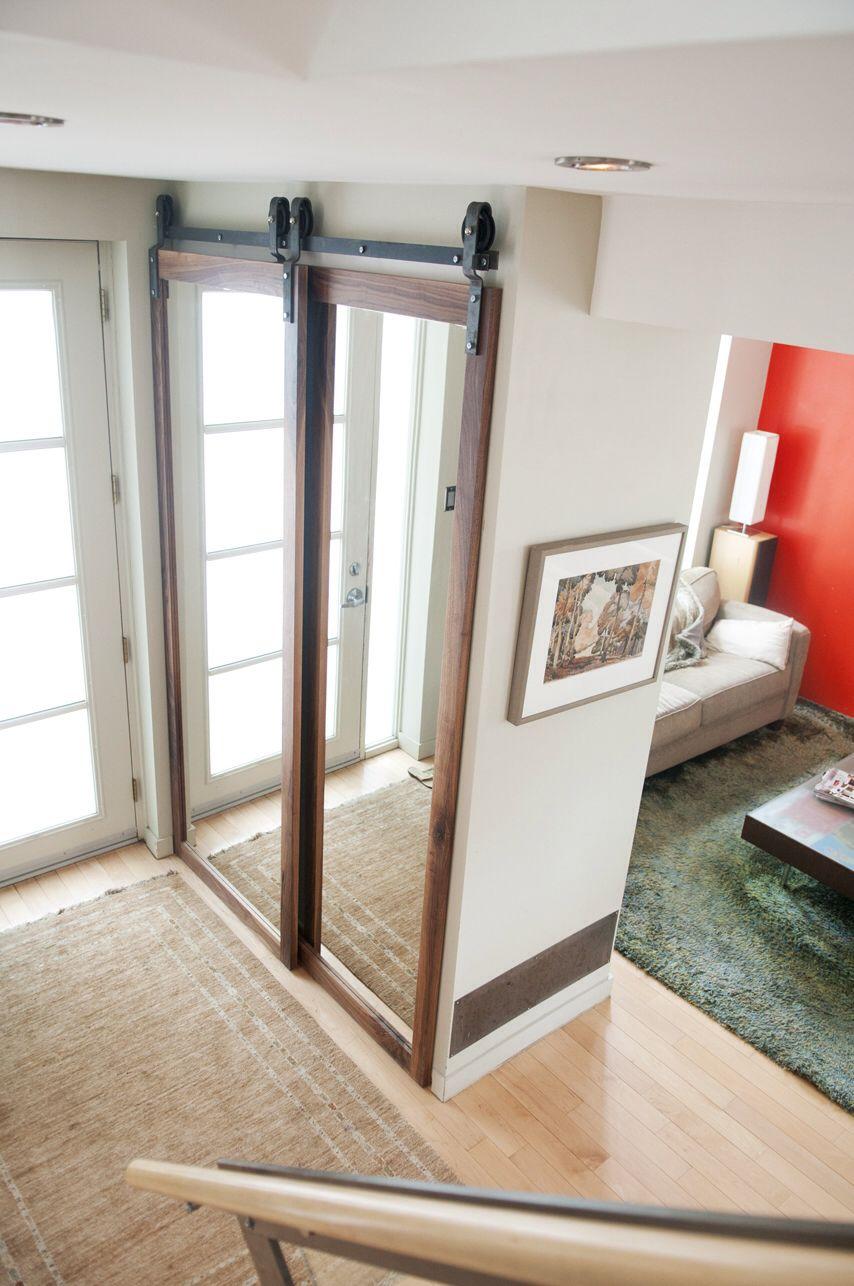 Bypass walnut frame mirror doors for a closet with