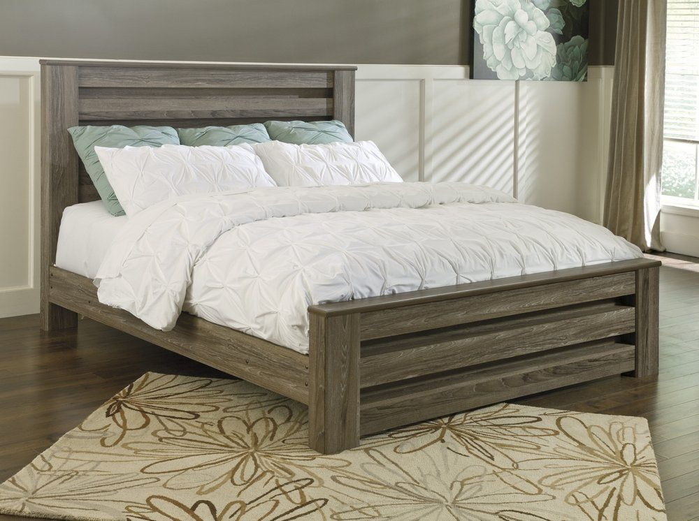 Signature Design Zelen Warm Gray Wood King Poster Bed by
