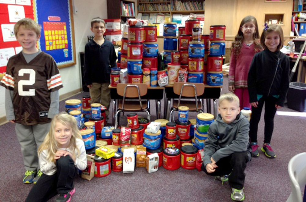 """Toth Elementary students have collected coffee to donate to the Toledo Firefighters. """"The students wanted to warm their hearts after the recent tragedy,"""" explained Angie Baumgartner, Intervention Specialist at Toth Elementary. The students also made cards for the Toledo and Perrysburg firefighters to show their appreciation for all they do to keep everyone safe. Members of the TFD will be coming during the lunch hour on Friday, February 14 to visit with the students."""