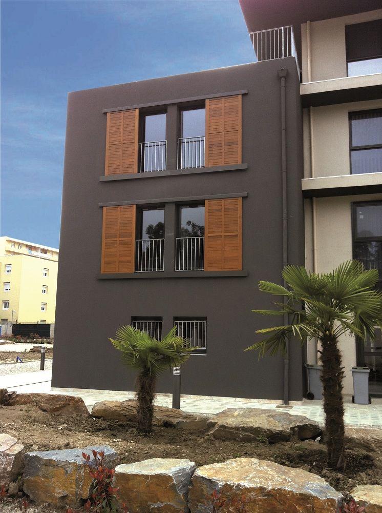 volets coulissant en bois solabaie pour une façade moderne
