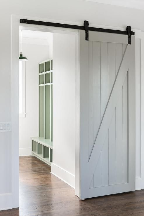 A Gray Mudroom Barn Door Customizes An Entryway Into A Mudroom With Green Beadboard Locker Styl Barn Doors Sliding Modern Sliding Barn Door Interior Barn Doors