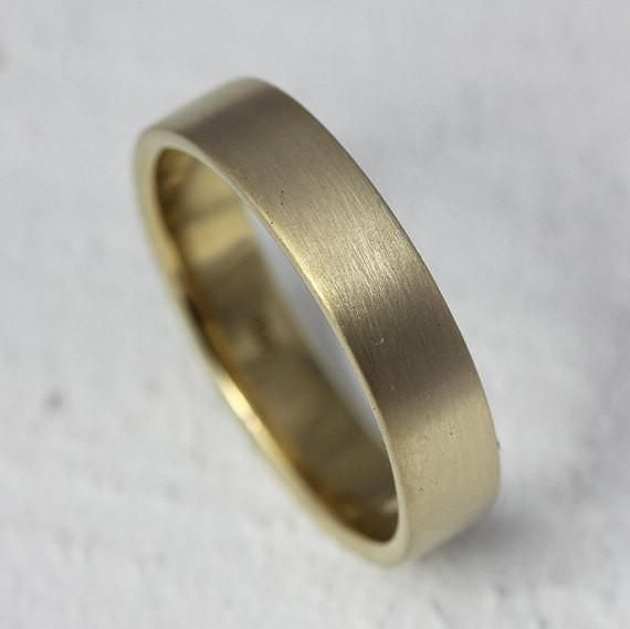 18k gold traditional wedding band ring. This18k solid gold wedding ring is as timeless as it is classic. The band is available in solid 18k yellow gold which are the first 4 photos, 18k palladium white gold (shown in the last photo), 18k white gold, 18k rose gold. A brush finish is applied to create a modern look and I can also polish the ring to a high shine. If you do not specify I will finish the ring with the brush finish shown in the photos.The ring measures 4mm high and 1.25mm…