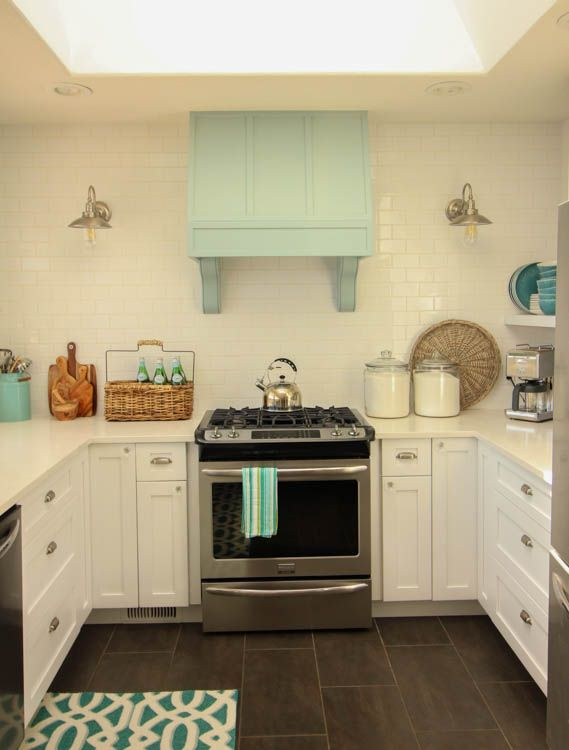 Gorgeous Coastal style white shaker kitchen with aqua blue at thehappyhousie.com-11