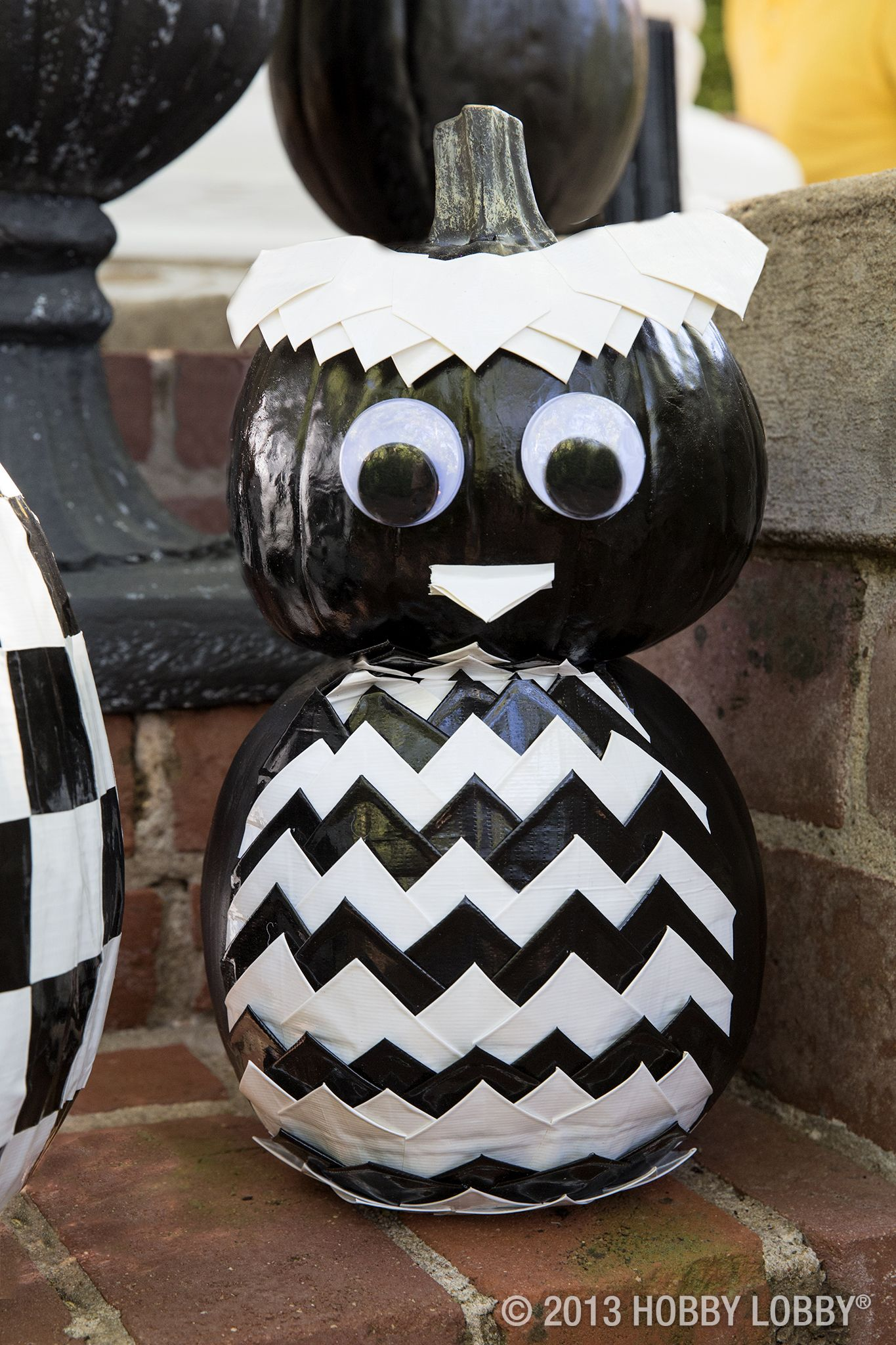 Use Duck tape and googly eyes to create a welcoming pumpkin for your