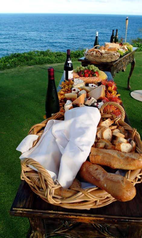 wine, bread and cheese by water