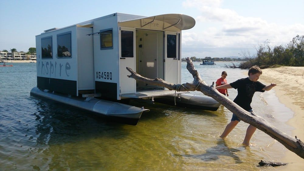 The side slide-outs increase interior space, and the pontoons move with them to keep things stable...