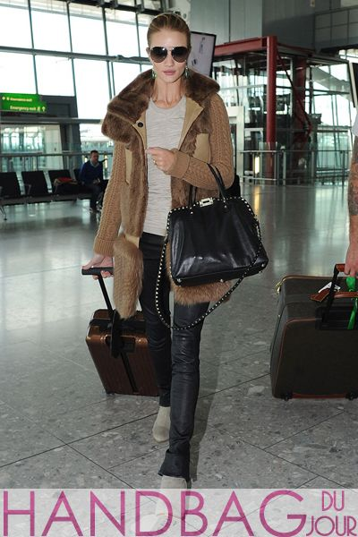 fb97fb1fea02 Rosie Huntington-Whiteley at Heathrow Airport in London toting a Valentino  Rockstud Dome Double Handle Bag handbag du jour