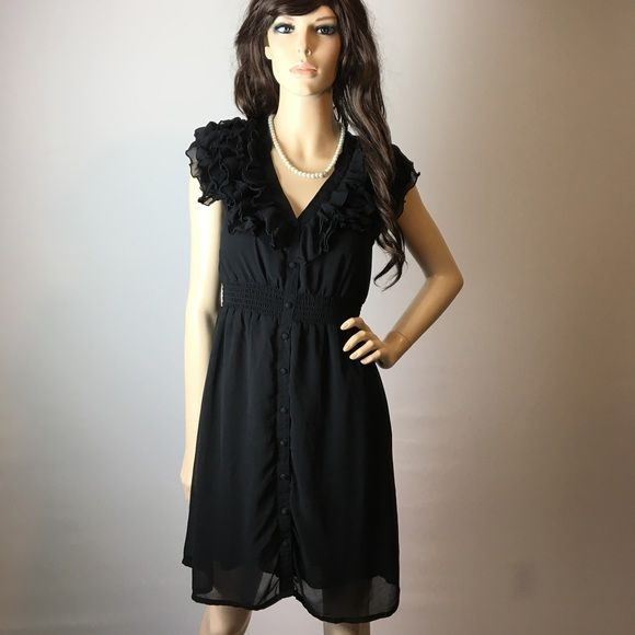 Darling H&M Black Ruffle Dress  Pre-owned in good condition. Darling little dress! I have a bundle discount and hundreds of lovely listings in all different sizes! My closet is full of tops, dresses, scarves, jackets, coats, sweaters, skirts, handbags, shoes and formal wear. I do not accept offers on items $10 or less, please make a bundle if you want a discount.  I normally ship within a day. Let me know if you have any questions.  -Zahadi H&M Dresses