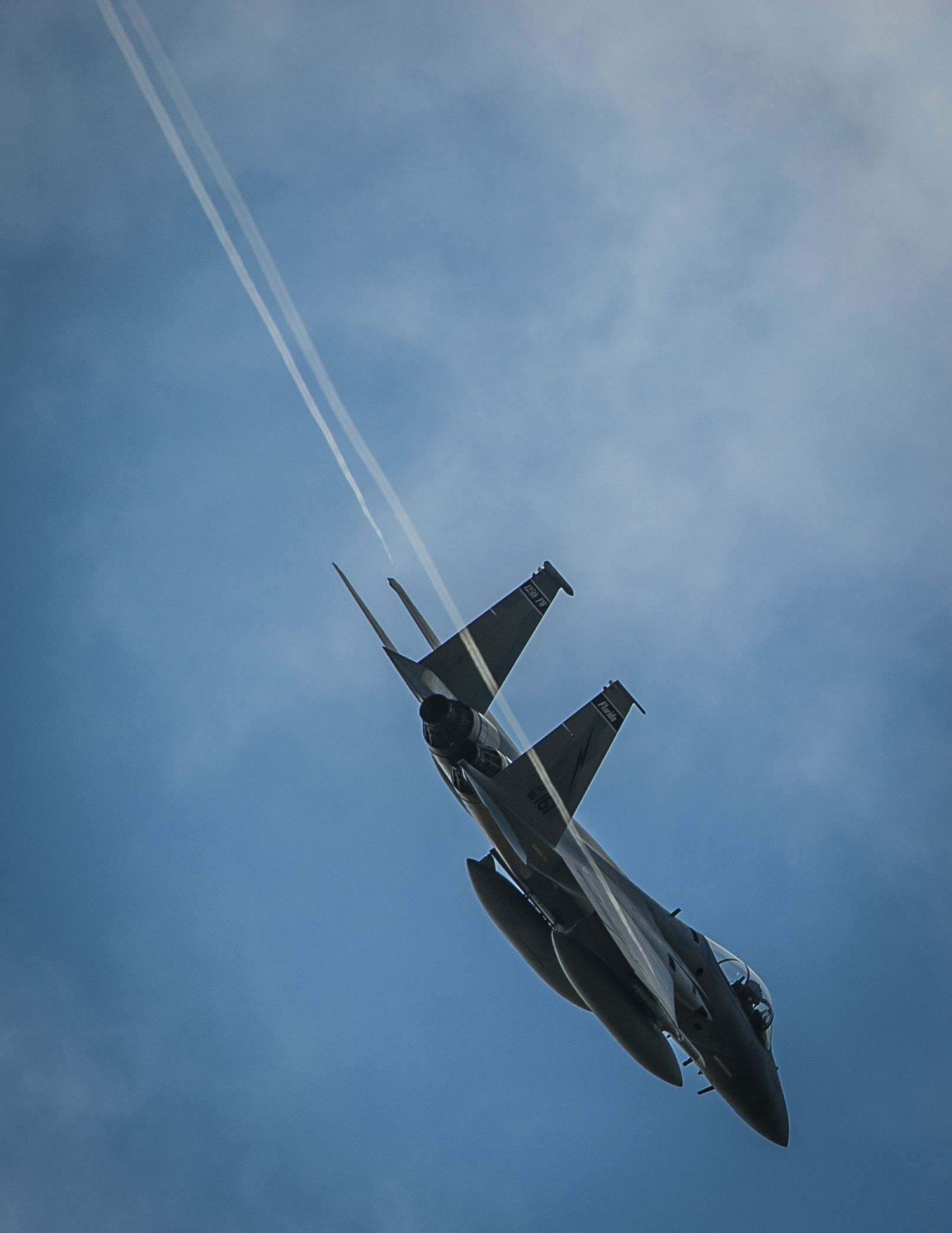 An f15c eagle peels off from the formation as it prepares