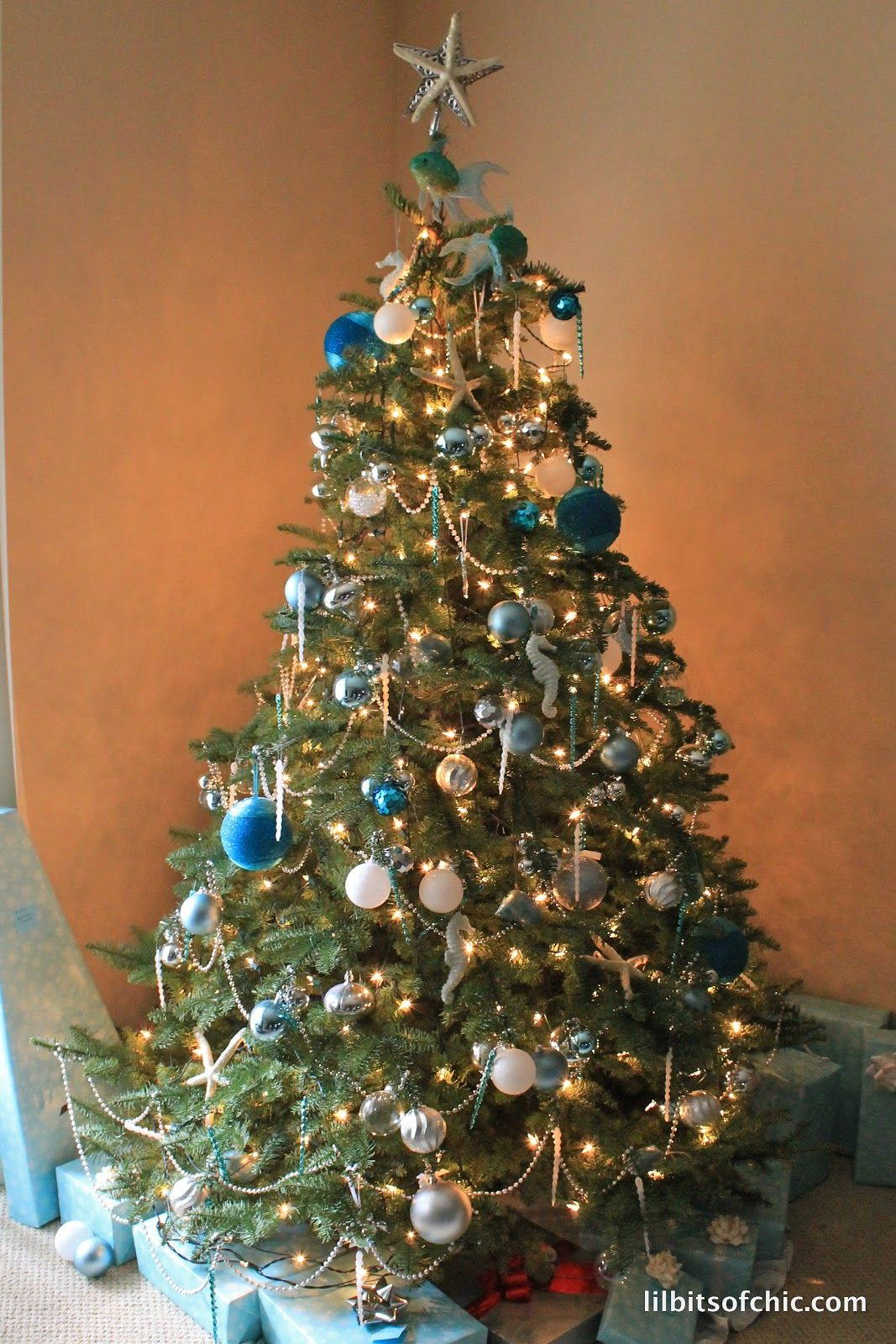 An Ocean Themed Christmas Tree with Ornaments from Kohl's: http://www.completely-coastal.com/2015/11/sea-inspired-coastal-christmas-collections.html