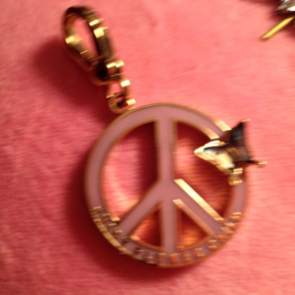 Juicy couture charm Juicy couture pink peace sign with beautiful butterfly on it lots of detail on the butterfly Juicy Couture Jewelry