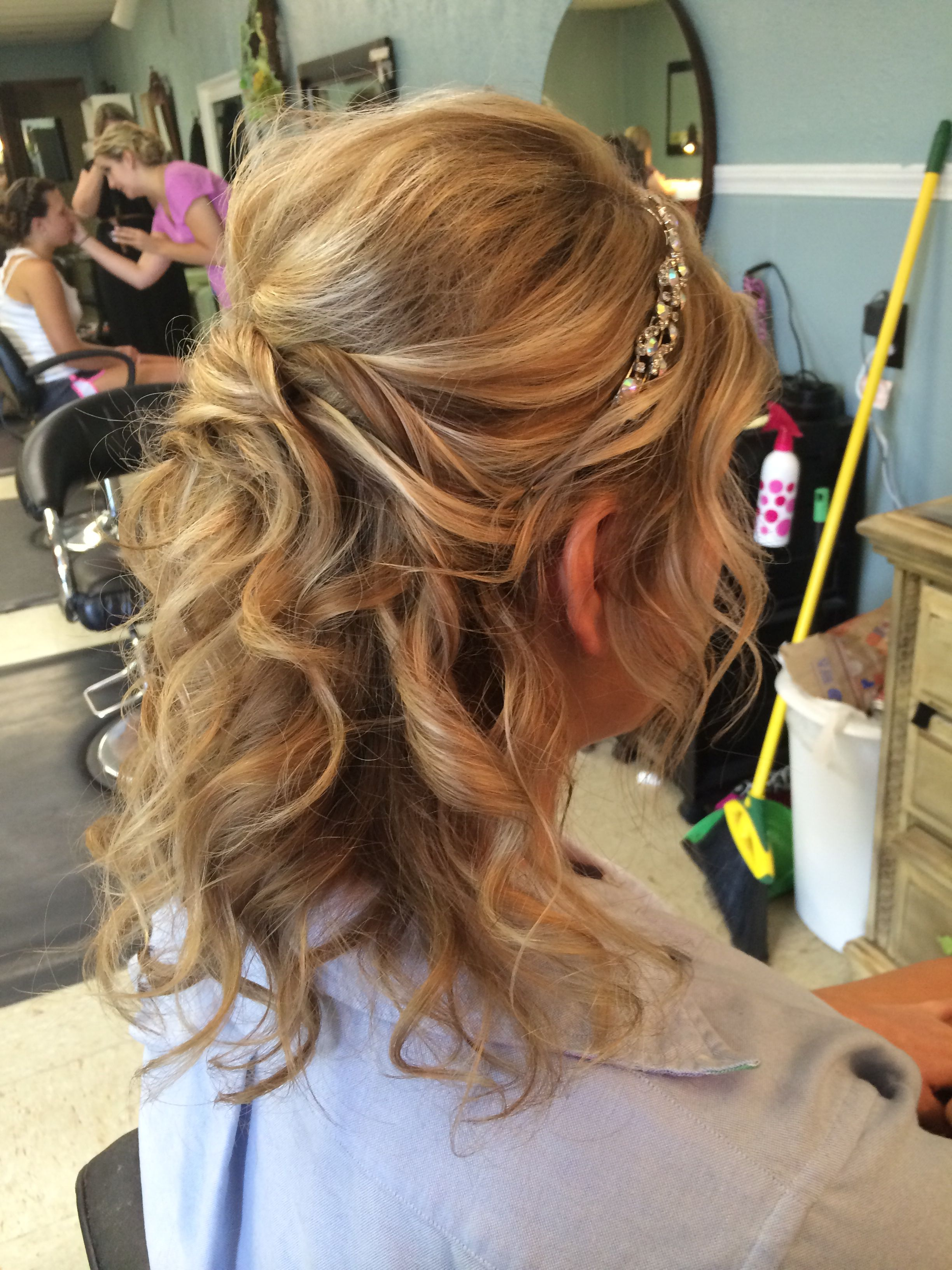 This is a gorgeous half up formal hair style done on medium length