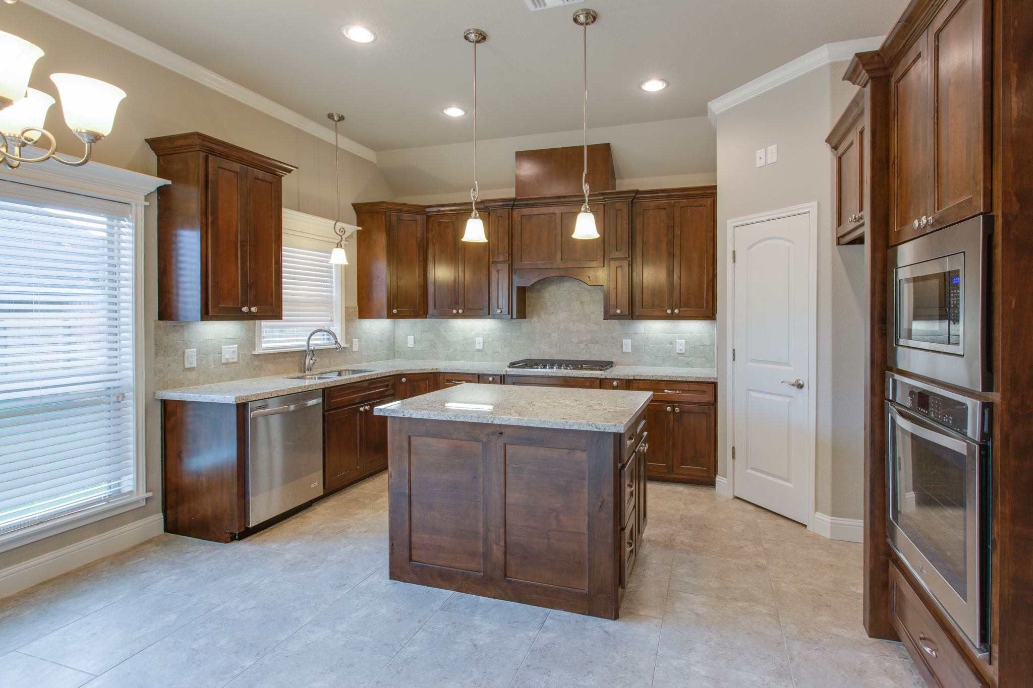 Stained Knotty Alder Cabinets With Brushed Nickel Fixtures And Hardware Knotty Alder Cabinets Alder Cabinets Dream Kitchen