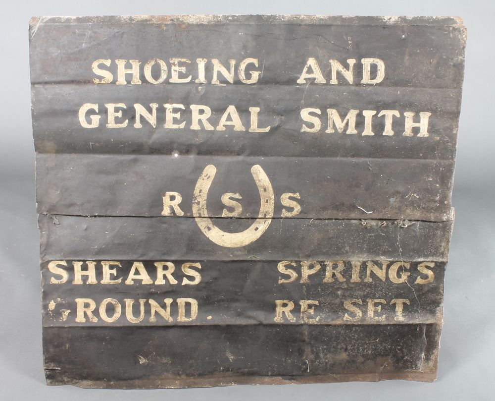 """Lot 246, A pressed metal sign """"Shoeing and General Smith RSS shears springs ground reset"""" 33"""" x 36"""", some corrosion and holes, Est £40-60"""