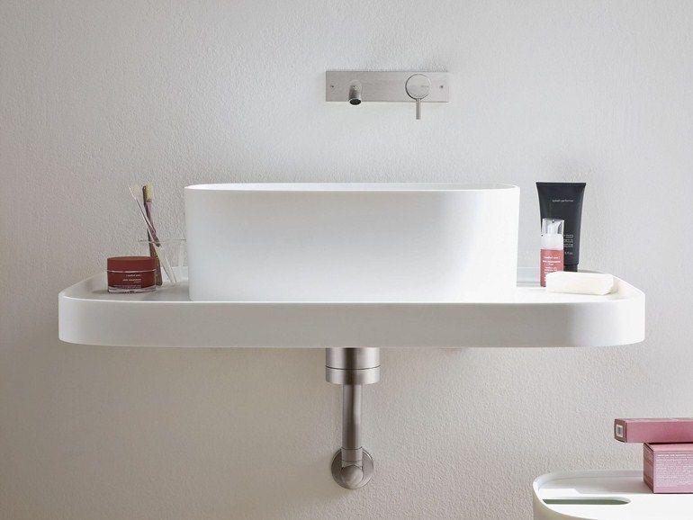 Lavatório suspenso de Corian® design Coleção Fonte by Rexa Design