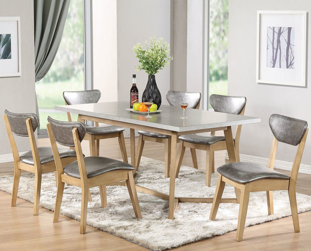 This dining collection has a set in metal like table top and ...