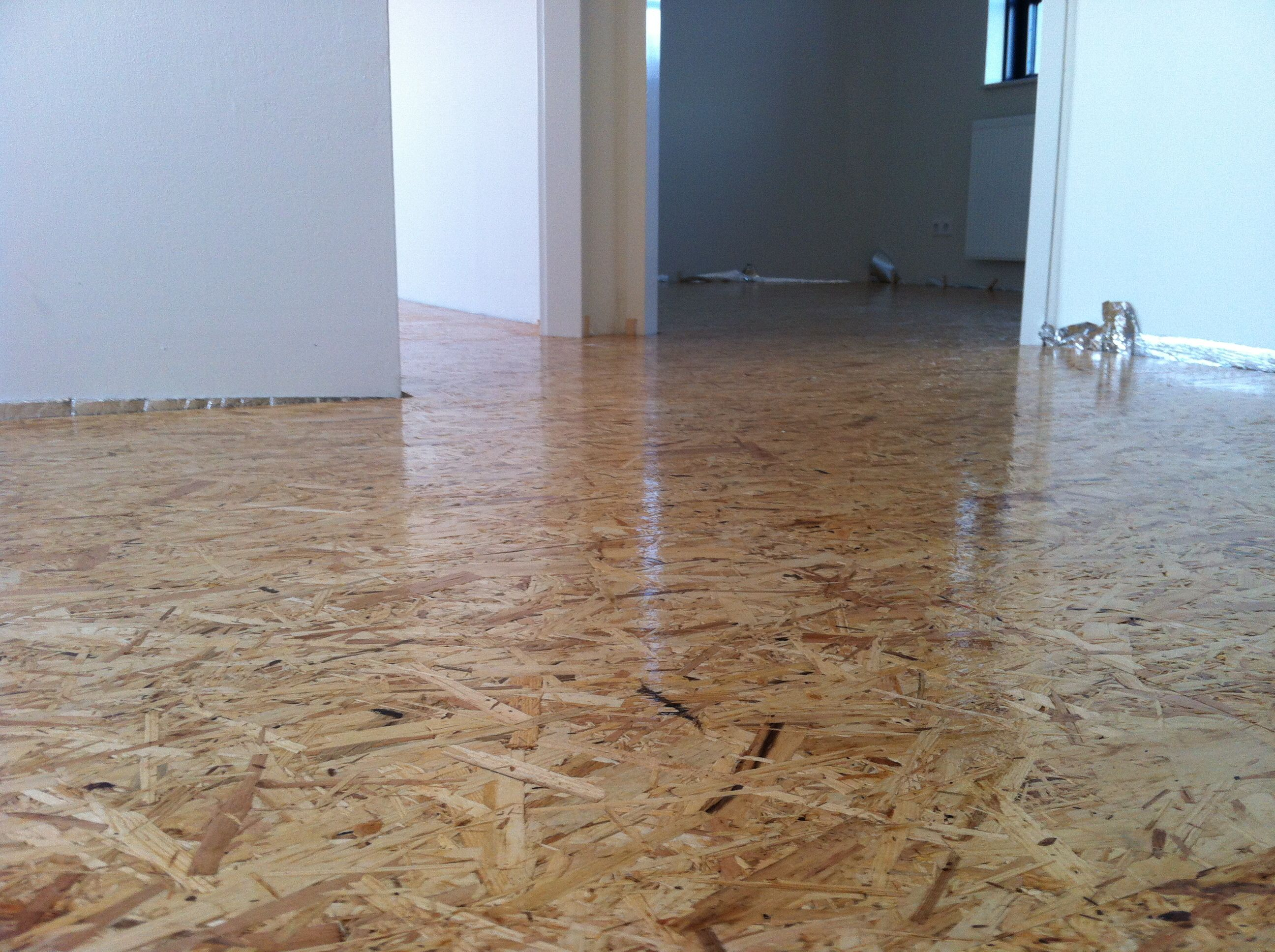 Oriented strand board as our wooden floor. With 3 layers ...