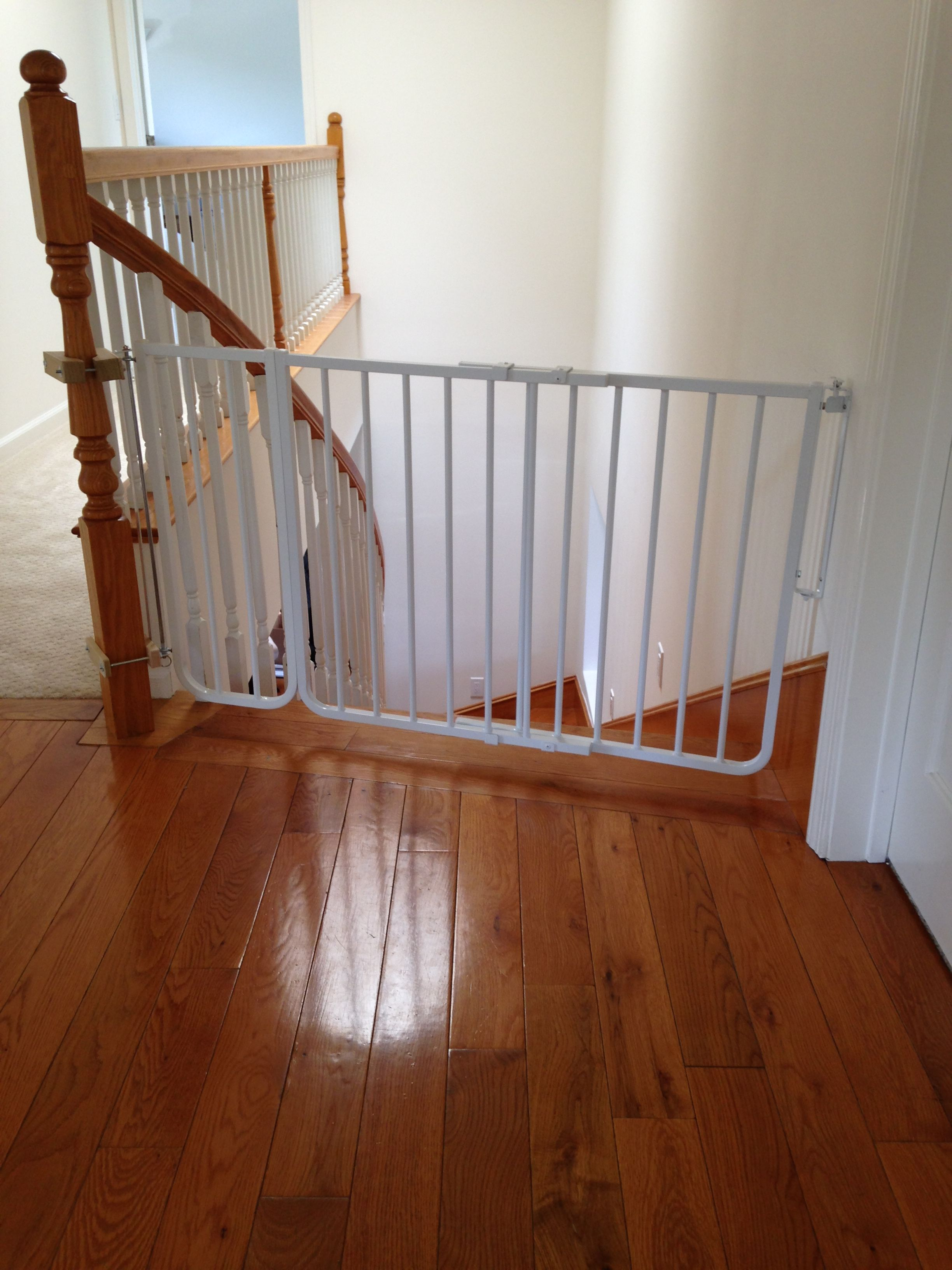 Successfully installed gate at the top of the stairs