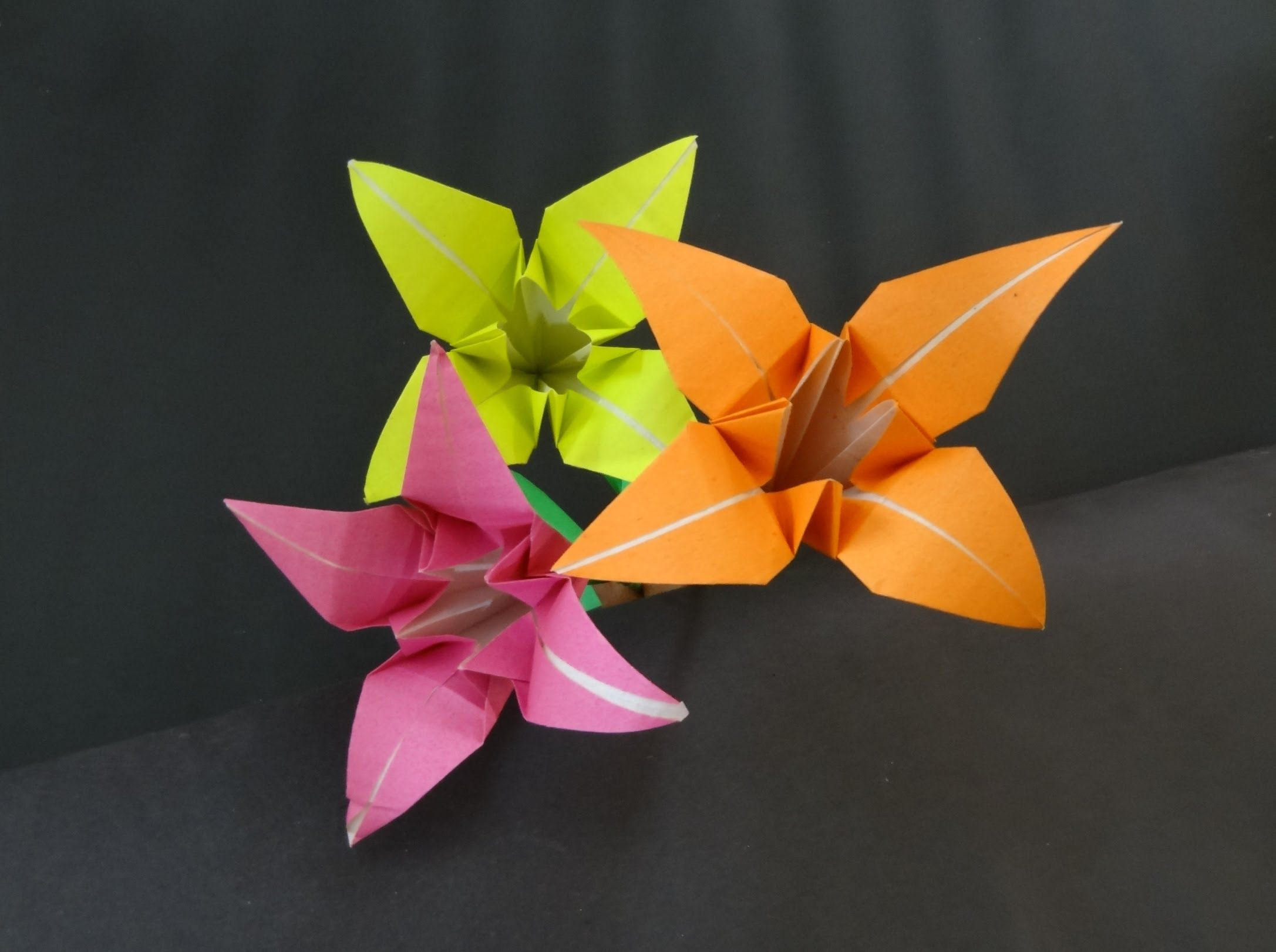 Paper flower tutorial how to fold origami lily flower crafts paper flower tutorial on how to fold origami lily flower this origami lily flower with stick is very beautiful and attractive origami paper flowers like mightylinksfo