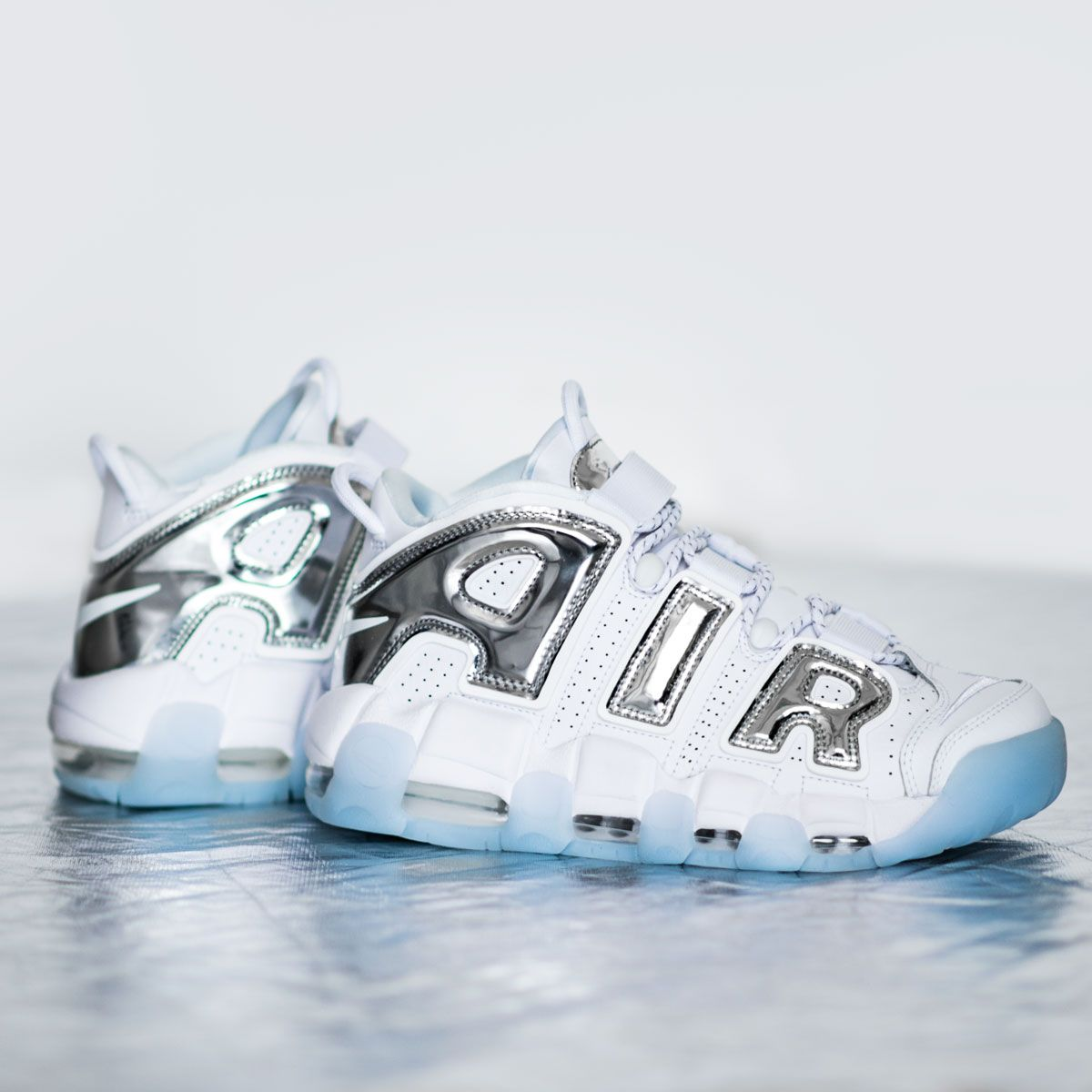 9583d6e7c2984 A new Nike Air More Uptempo for the Ladies is available now! Get these  white beauties with chrome lettering and an ice sole on KICKZ.com and in  selected ...