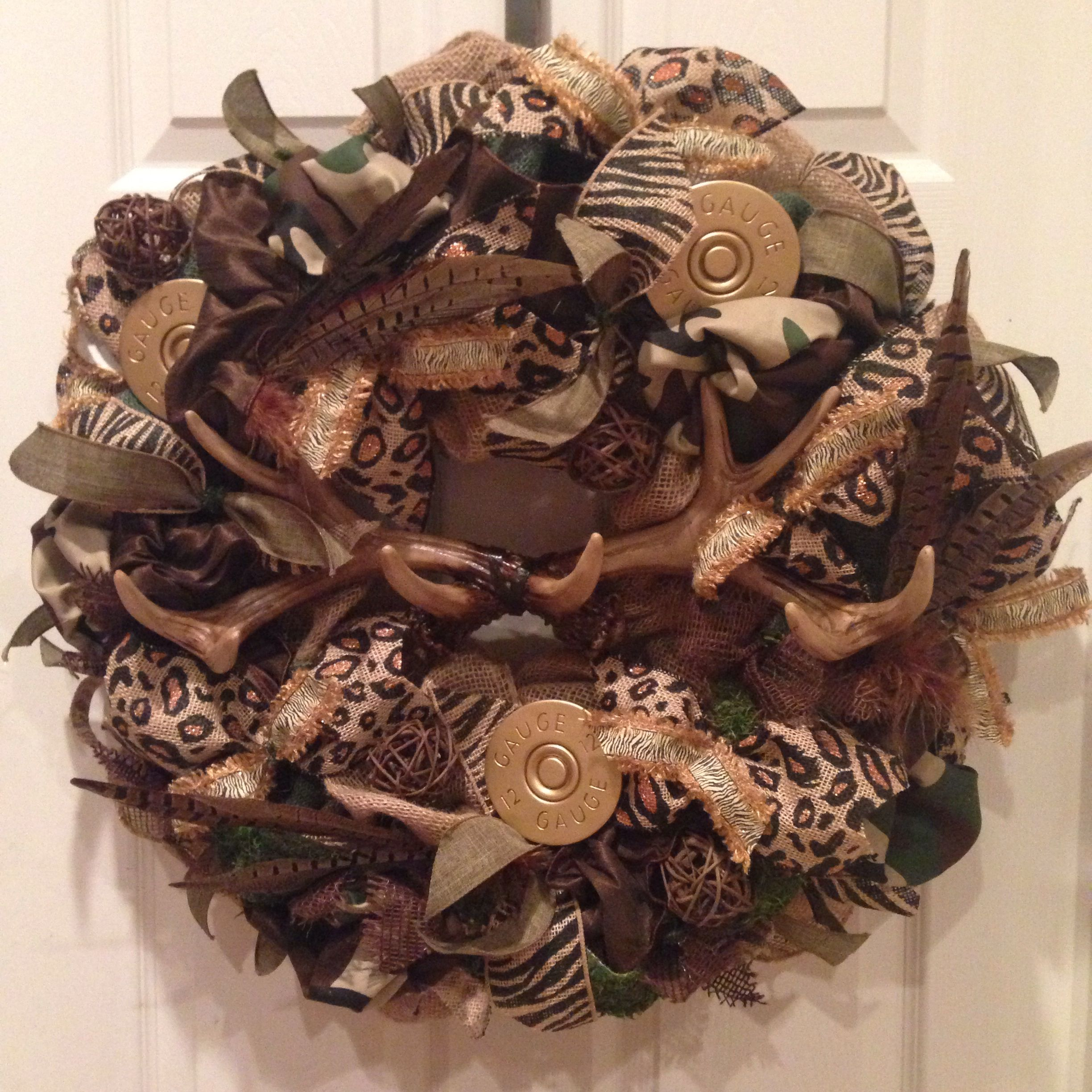 Country, hunting burlap wreath that was a custom order for a friend. Camo, burlap, feathers, antlers, zebra, cheetah, wicker and satin ribbon :)